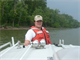 Jade Young, Louisville District, U.S. Army Corps of Engineers biologist, rides on the sampling boat while gathering samples to test water quality.